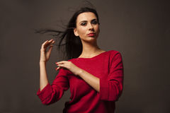 Caucasian brunette woman with smokie eyes poses Royalty Free Stock Image