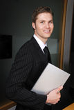 Caucasian business man holding a book Royalty Free Stock Images