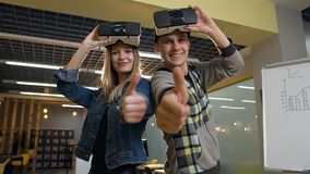 Caucasian business man and woman removing virtual reality vr glasses on the office background. stock footage