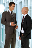 Caucasian business people talking in office Stock Images