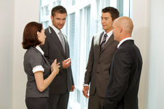 Caucasian business people talking in office Stock Image