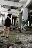 Caucasian business woman evaluating building. Successful young person writing report about demolished building for real estate industry Stock Photo