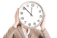 Caucasian business woman holding clock. Stock Image
