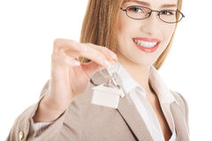 Caucasian business woman holds home keys. Stock Image