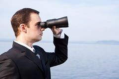 Caucasian businessman with binoculars Royalty Free Stock Photography