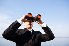 Caucasian businessman with binoculars Stock Photos