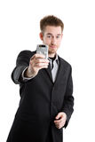 Caucasian businessman with camera phone Stock Photography