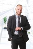 Caucasian businessman checking time Stock Photos