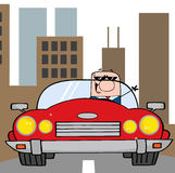 Caucasian businessman driving in the city Stock Images