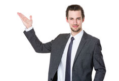 Caucasian businessman with hand present something Royalty Free Stock Photo