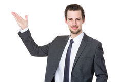 Caucasian businessman with hand showing with blank sign Royalty Free Stock Photography