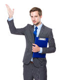 Caucasian businessman hold clipboard with hand presentation Royalty Free Stock Photo
