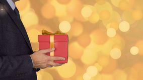 Caucasian businessman hold and give red gift box. Adult man in classic business suit hold red gift box. Abstract stock video footage