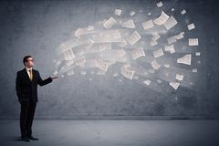 Caucasian businessman holding newspapers royalty free stock images