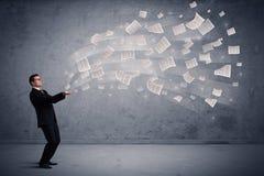Caucasian businessman holding newspapers Stock Photos