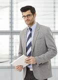 Caucasian businessman holding tablet Stock Photos