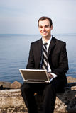Caucasian businessman with laptop Stock Photography