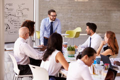 Caucasian Businessman Leading Meeting At Boardroom Table Royalty Free Stock Images