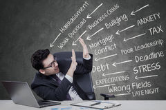 Caucasian businessman with many problems Royalty Free Stock Photo