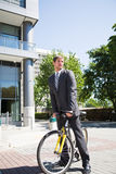 Caucasian businessman riding a bike Stock Photo
