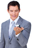 Caucasian businessman showing a service bell. Attractive Caucasian businessman showing a service bell against a white background Royalty Free Stock Images