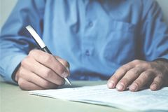 Caucasian businessman signing a contract. Stock Images