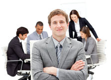 Caucasian businessman sitting in front of his team Stock Photos
