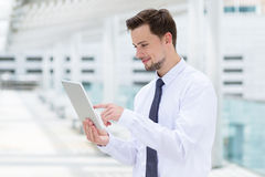 Caucasian businessman touch on digital tablet Royalty Free Stock Image