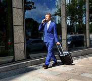 Caucasian businessman travelling making phone call Royalty Free Stock Image