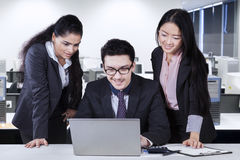 Caucasian businessman with two employees Stock Images