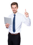 Caucasian businessman use digital tablet and finger up. European businessman isolated on white Stock Photo