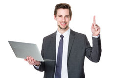 Caucasian businessman use of laptop and finger point up Stock Photography