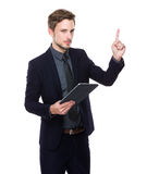 Caucasian Businessman use of tablet and finger point up Royalty Free Stock Photos