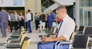 Caucasian businessman using laptop in the business seminar 4k stock video footage