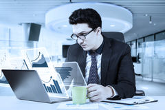 Caucasian businessman with virtual graph Stock Images
