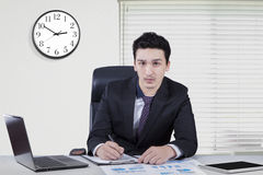 Caucasian businessman working in the workplace Stock Image