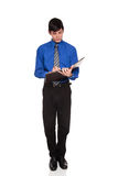 Caucasian businessman writing on blank notepad Stock Photos
