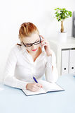 Caucasian businesswoman answering the phone. Royalty Free Stock Photo