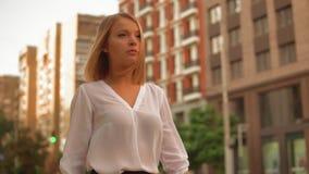 Successful woman walks on the street stock video footage