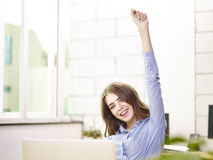 Caucasian businesswoman celebrating success in office Stock Images