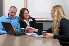 Caucasian businesswoman giving advise to couple Stock Images