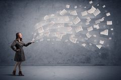Businesswoman holding newspapers Royalty Free Stock Photography