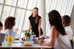 Caucasian Businesswoman Leading Meeting At Boardroom Table Royalty Free Stock Image