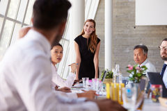 Caucasian Businesswoman Leading Meeting At Boardroom Table Stock Photos