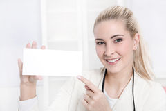 Caucasian businesswoman at office holding white board. Royalty Free Stock Photos