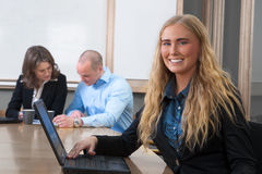 Caucasian businesswoman smiling at meeting Stock Image