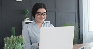 Caucasian businesswoman using laptop at office. Caucasian businesswoman working on laptop at office stock footage
