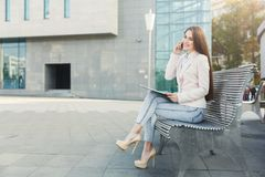Caucasian businesswoman working with papers outdoors Stock Image