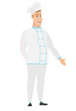 Caucasian chef cook with hand in his pocket. Royalty Free Stock Photos