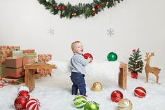 Caucasian child baby celebrating Christmas or New Year royalty free stock photo